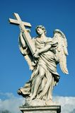 Statue of angel with holy cross. Marble angel with the Holy Cross from Ponte Sant`Angelo bridge, in the center of Rome, Italy Stock Image