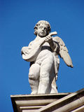 Statue of angel with lute. Angel with lute, statue on church Stock Images