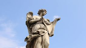 Angel  Statue on the Ponte Sant` Angelo bridge, Rome. Statue of Angel with the Nails on Ponte Sant`Angelo in Rome. Every statue of angel on the bridge bears the stock footage