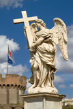 Statue of Angel at Sant Angelo Bridge in Rome Italy with Italian Flag Stock Photo