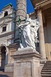 Statue of an angel in St. Charles Church. Vienna, Austria. Statue of an angel in front of Saint Charles Church (Karlskirche, 1737). Karlsplatz, Vienna, Austria Royalty Free Stock Photo