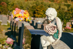 Statue of an angel on a tombstone Stock Photos