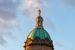 Statue of an angel on top of a historical building in Edinburgh stock photo