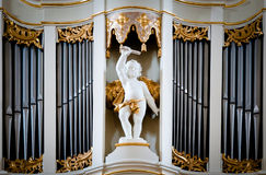 Statue of angel at Vilnius cathedral organ. Stock Photography