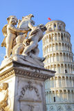 The statue of angels and Leaning Tower Royalty Free Stock Photography