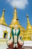 Myawaddy, Myanmar : Statue angle and pagoda. Royalty Free Stock Photos
