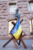 Statue on the antitank in Kiyv Royalty Free Stock Photos