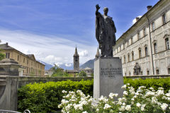Statue in Aosta. Statue and church in Aosta Stock Photography