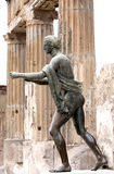 Statue of Apollo in the ruins of Pompei, Italy. A statue of Apollo, god of prophecy, music, and healing to the Greek and Romans, in the pose of an archer was one Stock Images