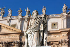 Statue of Apostle Paul with a sword in St. Peter's Square, Rome. Statue of Apostle Paul in St. Peter's Square with blue sky background, Rome, Italy Stock Photo