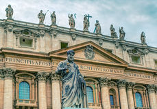 Statue of apostle Peter in front of the Basilica of St. Peter in Stock Images