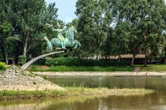 The Raba river flows into Mosoni-Duna river. Statue Aquatic Foal by Makrisz Agamemnon in the Raba river in Gyor. Hungary Stock Photos