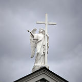 Statue of the archangel with a cross Stock Images