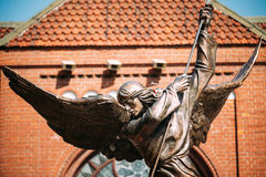 Statue Of Archangel Michael near Red Catholic Church Of St. Simon And St. Helena Stock Images