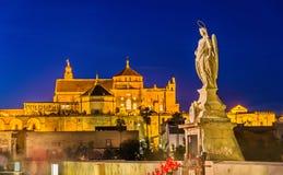 Statue of Archangel Raphael on the Roman Bridge in Cordoba, Spain Stock Photos