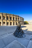Statue and Arena of Nimes in France Royalty Free Stock Images