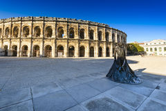 Statue and Arena of Nimes in France Royalty Free Stock Image