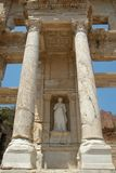 Statue of Arete at Celcus Library in Ephesus, Turkey. Statue of Arete between two marble columns at Celcus Library in Ephesus, Turkey Stock Photos