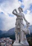 The statue of Artemis and a deer made from marble. Above a city. The hunter and the deer Stock Photo