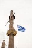 Statue of Athena and the Greek flag Royalty Free Stock Photography