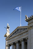 Statue of Athena and the Greek flag Royalty Free Stock Photos