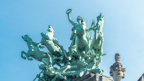 Statue atop the Grand Palais on the Champs Elysee timelapse. Paris, France. Close up view with blue sky stock video