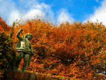 Statue and autumn colors. In Cloudehill gardens, Dandenong Ranges, Victoria, Australia Royalty Free Stock Image