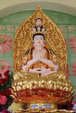 Statue of Avalokitesvara sitting on lotus flower Stock Photos