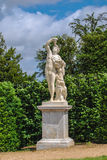 Statue of Bacchus with grape in the Gardens of Versailles. France Stock Images