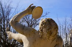 Statue of Bacchus in park. Blue background. Statue of Bacchus in park. Spring park blue background Stock Images