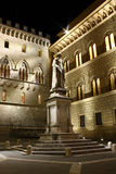 Statue of Bandini, Siena. A night shot of the statue of Bandini, Salimbeni square, Siena Stock Image
