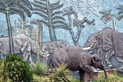 Display at a paleontology museum. Statue and bas relief wall at a paleontology museum in Bolivar, Ecuador royalty free stock photos