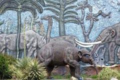 Display at a paleontology museum. Statue and bas relief wall at a paleontology museum in Bolivar, Ecuador stock photos