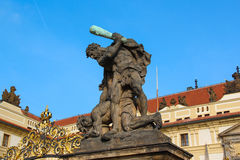 Statue of Battling Titan at the gate of Castle in Hradcany, Prague, Czech Republic Royalty Free Stock Image