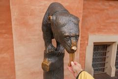 Statue of a bear with a long tongue at the Town Hall in Wroclaw. Poland stock photos