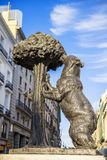 Statue of Bear and strawberry tree Royalty Free Stock Image