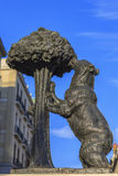 Statue of Bear and strawberry tree Stock Photography