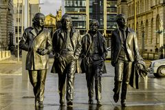 The statue of The Beatles on Liverpool`s waterfront, UK. The statue of The Beatles on Liverpool`s waterfront on Liverpool street royalty free stock images