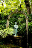 Statue in a Beautiful Garden at Monte above Funchal Madeira. This wonderful garden is at the top of the cablecar from the seafront in Funchal. It is filled with Royalty Free Stock Photos