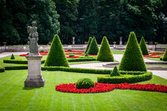 Statue in a beautiful park. Statue and clipped trees and bushes in a classical park royalty free stock photography