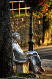 Statue on a bench. Statue of a croatian poet Antun Gustav Matos sitting on a bench beside Strossmayer Promenade in Zagreb. A very popular tourist attraction Stock Image