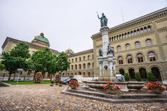 Statue of Berna Bernabrunen, a personification of the city of Bern, by Raphael Christen 1858 in front of the Bundeshaus West. Parliament, Bern, Switzerland Royalty Free Stock Photo