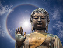The statue of Big Buddha face with hand in Hongkong Royalty Free Stock Photography