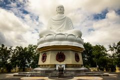 Statue of Big Buddha in Long Son Pagoda royalty free stock photography