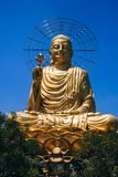 Statue of Big Golden Sitting Buddha in Dalat stock image