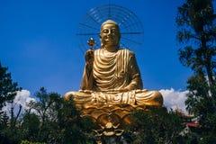 Statue of Big Golden Sitting Buddha in Dalat royalty free stock photos