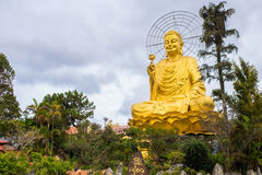 Statue of Big Golden Sitting Buddha in Dalat, Vietnam Royalty Free Stock Images