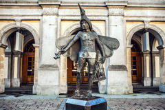 Statue of bird-catcher Papageno (character of Mozarts opera) in front of Stadsschouwburg Theatre. Royalty Free Stock Photography