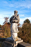 Statue of a bishop with a cross Royalty Free Stock Image