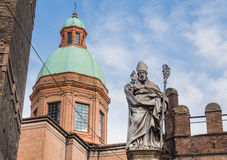 Statue of Bishop St. Petronius, Garisenda tower.  Bologna, Italy Stock Images